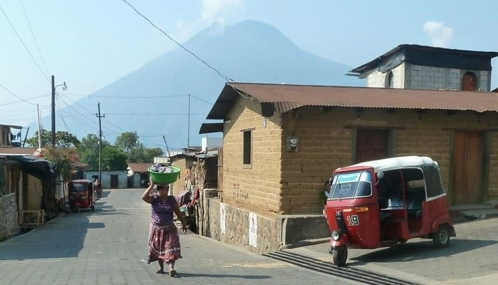 Social media in Guatemala / This woman probably has a cellphone on her. Ditto the tuk-tuk driver