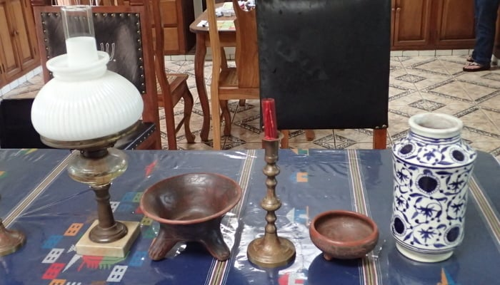 Art in Nicaragua: Kerosene lamp, circa 1850; candle stick holder, circa 1800; Managua polychrome tripod, circa 1400 A.D. made by Teodulo Potosme; Usulutan Resist small bowl, circa 200-400 A.D. made by Teodulo Potosme. 16th century alborello, or apothecary jar, made by Teodolo Potosme / Pat Werner