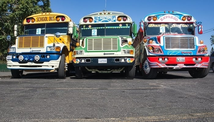 Guatemalan economy / Chicken buses / Photo by Alexander Schimmeck on Unsplash